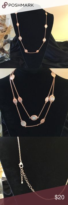 ParkLane close outs Beautiful extra long necklace of rose gold solid disc & some with clear crystals. Can be worn single or doubled. 2inch extender.m Park Lane Jewelry Necklaces