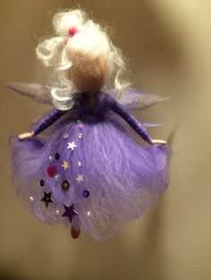 Fairy is in a dress the color of violet. Bright and elegant decoration for home, for the childrens room, a Christmas tree .... or unusual gift.  The