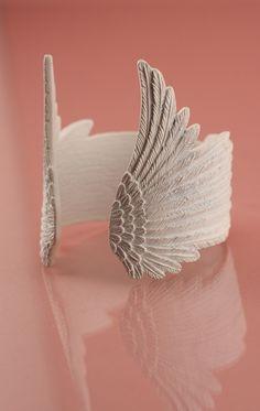 Wildfox Coture matte white wing cuff