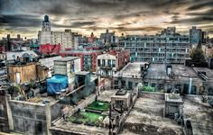 """All Photography Art Exhibition - 2nd Place - Pam Borrelli - """"SoHo Rooftops"""" - Pam is a San Francisco, CA based photographer. She attended the San Francisco Art Institute and later earned a Master's Degree in Psychology from the University of San Francisco. Pam's photography focuses on the interplay between reality and imagination. Pam states, """"My goal is to capture a glimpse of that which surrounds us but which we often only vaguely sense and do not clearly see... www.borrelliportraits.com"""