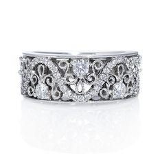 Perfect as an evening wear ring or even a dazzling diamond wedding band, this vintage-inspired band features charming cutout details and exquisite pave diamonds.