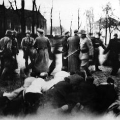 Round up on the Jonas Daniel Meyerplein in Amsterdam. Jews arrested were forced to lay on the ground. Probably Feb. 22nd, 1941, the first round up of Jews in the Netherlands.