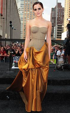 Emma Watson looking AMAZING in this golden stunner