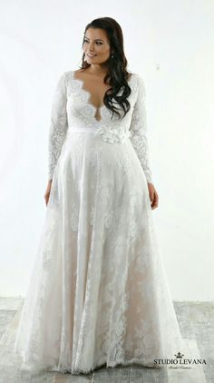 Perfect light romantic plus size wedding gown. French lace, long sleeves, deep V neck. Sophia. Studio Levana #weddinggowns
