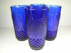 Brilliant set of 4 Avon Royal Sapphire cobalt blue glasses. Glasses are each 5 tall and 3 wide. Stunning color and pressed diamond/fan/leaf pattern. Made in France.