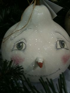 Hand painted and glittered hard shelled gourd snow man.