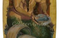 Mermaid & Abalone hand painted on a 6' surfboard.