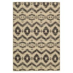 Anchor your dining set or living room seating group with this eye-catching rug, showcasing an ikat motif for exotic style.   Product...