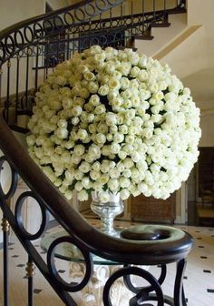 white roses...silver vase....huge....fitting for a luxurious lesbian wedding