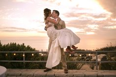 Love the sunset during this photo from their ocean view wedding in Palos Verdes! Photography by Christopher Brown Photography.