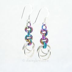 Bright and colorful, these precious Rainbow Tea Rose earrings are hand woven with sterling silver for the stylized rose bud, and multi-color anodized niobium for the stems, exceptionally comfortable to wear. Fitted with 925 sterling silver ear wire. Also available with sterling silver ear posts.