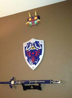 """""""youve met with a terrible fate havent you"""" yes i did. wall decor that im starting along with my other zelda collection. going to make the goron, deku, and zora mask soon. hylian shield and mastersword look sexy"""