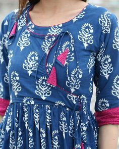 Shop online Angrakha tasseled dress This features an angrakha style inspired dress with tassels in the front. The dress has rolled up sleeves along with side zipper for the perfect fitting Designs For Dresses, Dress Neck Designs, Blouse Designs, Churidar Neck Designs, Kurta Designs Women, Latest Kurti Designs, Kurti Sleeves Design, Kurta Neck Design, Mini Frock