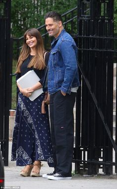 All smiles: Joe - who stars in Magic Mike - wore a denim jacket as he towered over the 5ft...