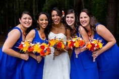 We love how radiant this bride is surrounded by her bridesmaids in cobalt blue and all those brilliantly colored flowers | Annmarie Sculpture Garden and Arts Center in Maryland | Photographer: The Madious