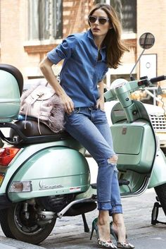 Olivia Palermo offsets her casual shirt with high heels and a sleek mint Vespa.