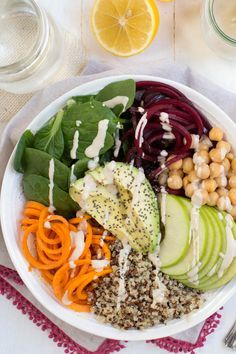 Harvest Buddha Bowl with Lemon Tahini Dressing is made with fresh spiralized beet and sweet potato noodles, spiralized apple, chickpeas, spinach and more! Pack this bowl for lunch to fuel up for the day.