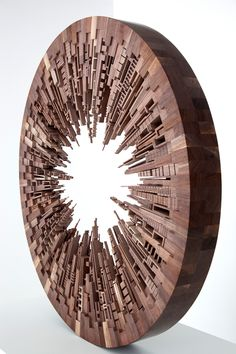 Wooden cityscape sculpture by james mcnabb