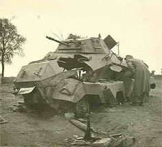 A destroyed Sdkfz 231 8 rad armored car.