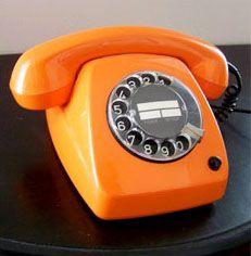 Orange Rotary Dial Phone... I want, I want, I need, I need. This will be my orange Flyers phone :)