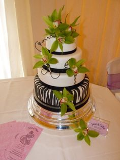Love the zebra but I'd have part of the cake be green and no flowers