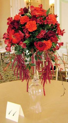 Centerpiece Featuring Roses, Orchids, Carnations and Hanging Amaranthus