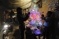 Here Comes Nick: Christmas Celebrations Around the World - NBC News.com  Pakistani Christians decorate a Christmas tree on a street in Islamabad on Dec. 24. Christians in Pakistan form the country's largest minority, accounting for 1.6 per cent of the population.