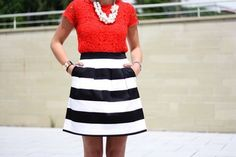 Red lace top, white chunky necklace, black and white striped skirt