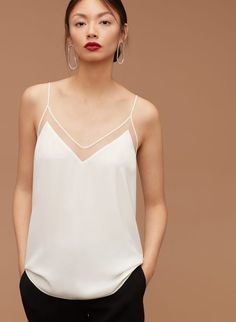 A white classic dressy and casual camisole.