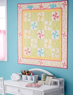 Embellish spinning pastel Pinwheel blocks with sweet details—rickrack, buttons, and just a touch of fusible appliqué.