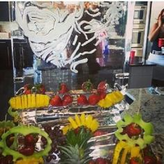 Add fruit to an ice sculpture