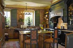 eclectic French Country Kitchen with painted cabinets and brick walls