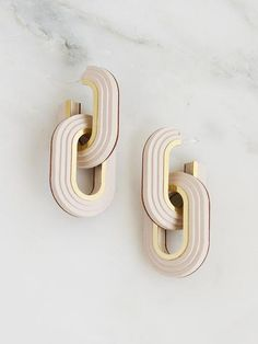 Stunning statement earrings made with handpainted wood and delicate brass detailing, available in two complementary colourways. From the new Collection No. 7.