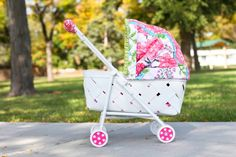 Make your own kid-sized baby doll pram with a basket and an old stroller!