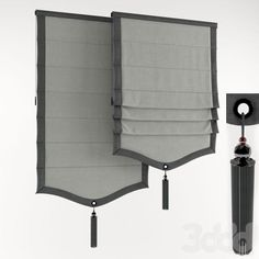 Single scallop and tassel light gray pleated Roman shade with charcoal trim and center tassel