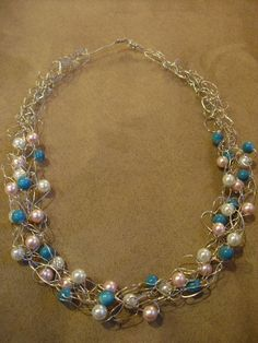 Crocheted wire and pearl necklace.