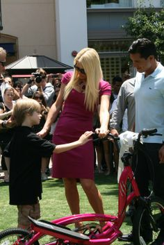 Paris Hilton and Mario Lopez checking out the new Zike presented to Paris.