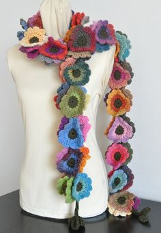 Thanks for looking  This scarf is made with multicolor wool yarn, dark green wool and acrylic blend yarn. All the 63pcs of 3.5-3.75 flowers are all hand crocheted. the length is about 75。 Length can be made to order.