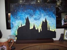 Silhouette of Hogwarts, and the swirlies in the sky are favorite HP quotes. painted by jmiller614