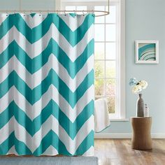 The Mi Zone Libra shower curtain gives you an updated modern look. The overscaled design features a herringbone print teal and solid white chevron pattern printed on polyester microfiber for easy care.
