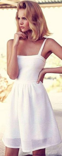 Christian Dior White Summer Dress. It's probably a couple hundred dollars or more, but it's really cute.