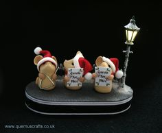 I, JS Miniatures produced the base with lit lamp post and Kirsten of Quernus Crafts made the 3 carol singing mice.  A tiny switch switches the lamp off and on and the base comes with a little fence and snow. Battery can be replaced.
