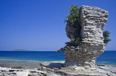Flower Pot Island, Ontario | This popular tourist island in Georgian Bay is part of Fathom Five National Marine Park. Accessible only by boat, the island is home to two limestone rock pillars, which are named for their striking resemblance to flower pots.