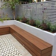 Garden seating - Custom hardwood seat with storage Timber trellis screens Perennial feature planting, Silver birch courtyard tree Construction by Germinate Gardens Garden seating, Backyard landscaping Back Garden Design, Cottage Garden Design, Backyard Garden Design, Backyard Seating, Small Backyard Landscaping, Backyard Patio, Built In Garden Seating, Courtyard Landscaping, Courtyard Design