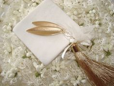 Quest Favor With gold olive tree leaves.