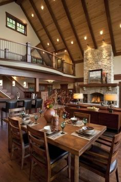 High to the ceiling with lots of space for large personalities. It reminded me of a wonderful log house at Shawningan Lake B.C. an acquaintance of mine has built. (by Living Stone Construction, Inc.)