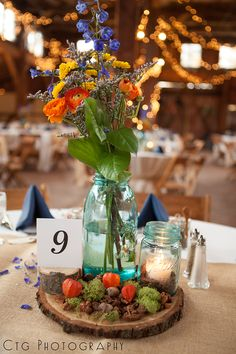 blue mason jar with orange flowers