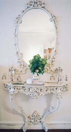 French Photo - An ornate mirror and table against white walls- cute for the salon side or even in the entry way at the cafe maybe near the bathrooms