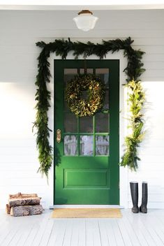 Love the green door and Christmas decorations