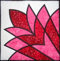 Chantell's Creations - Designs. This is a cleopatra's fan block, but used for applique (outlines are a satin stitch).